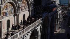 Tourists on the external balcony of San Marco Saint Mark's Church Venice Stock Footage