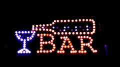 Illuminated sign «Bar», blurred into the darkness. Stock Footage