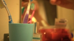 Man puts back brush from a plastic cup Stock Footage