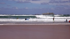 Boys teen surfing in Cantabrian sea Stock Footage