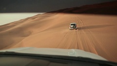 Desert Safari SUVs bashing through the arabian sand dunes. View from the car 1 Stock Footage