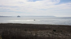 Wide Morro Bay CA serene ocean and clouds Stock Footage
