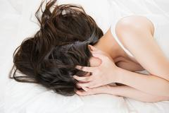 Beautiful asian woman feel unwell painful and ill Stock Photos