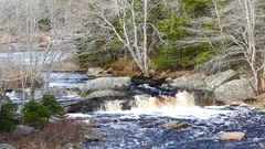 Close Up of River With Small Waterfalls, Rocks and Moving Water Stock Footage