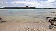 Santiago island seen from the beach of  Chinese Hat island in Galapagos, Ecuador Stock Footage