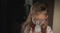 Girl makes inhalation with nebuliser Stock Footage