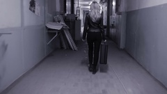 Young business woman runs away with suitcase. Stock Footage
