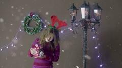 Beautiful Santa helper Christmas girl holding candy jar on Christmas decorations Stock Footage