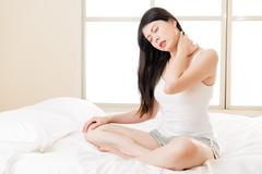Beautiful asian woman suffering Shoulder neck ache pain tired Kuvituskuvat