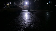 Rain in a dark courtyard at night Stock Footage