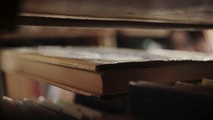 Young girl with glasses old book found in the library Stock Footage