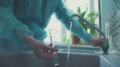 Laboratory chemical glassware washing using a solution Stock Footage