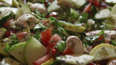 Rotating Fresh Chopped Variety of Vegetables Mixed with Raw Chia Seeds Stock Footage