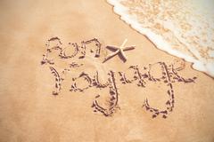 Bon voyage written on sand Stock Photos