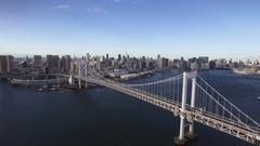 Beautiful Tokyo Rainbow Bridge aerial left movement Tower background  Stock Footage