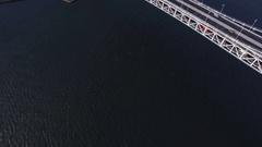 Backwards reveal Tokyo Bay Rainbow Bridge aerial  Stock Footage