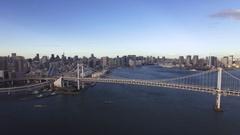 Wide angle aerial Tokyo Bay Rainbow Bridge Skyline  Stock Footage