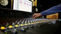 Closeup Mixing Consol Guy Hand Pushes Faders by Computer Stock Footage