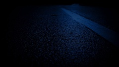 Moving Over Road Markings In Moonlight Stock Footage