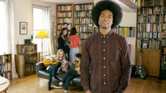 4K Time lapse students in shared home, man stands still & is piled with books Stock Footage