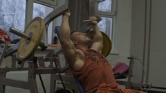 Muscular bodybuilder guy doing exercises in gym.Man working with weights in gym Stock Footage