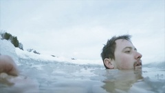 Young man in the ice hole Stock Footage