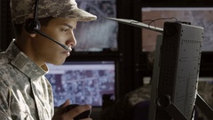 Portrait of a military drone operator, wide shot Stock Footage