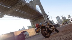 Parked motorcycle beneath New York City's Brooklyn Bridge - summer - 4k Stock Footage