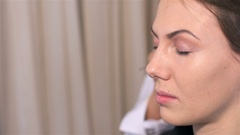 Makeup artist deal makeup on eyelids with special brush Stock Footage
