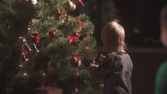 Two brothers decorating a Christmas tree Stock Footage