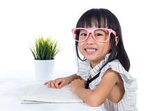 Smiling Asian Chinese little office lady reading book Stock Photos