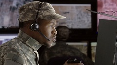 Profile shot of a military drone operator Stock Footage