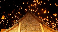 Release floating lanterns to the sky near a Lanna temple Stock Footage