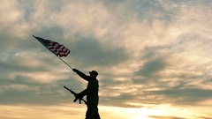Soldier, automatic rifle,  and  American Flag. Slow Motion.  Stock Footage