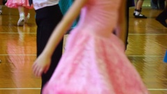 Close-up of legs dancing couples in ballroom Stock Footage