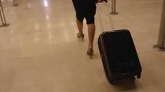 Elegant businesswoman pulling the suitcase Stock Footage