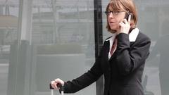 Businesswoman talking on the smarthphone Stock Footage