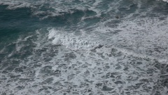 Slo mo high angle view of Pacific ocean rip curl breakers coming to shore 2 Stock Footage