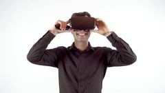 Man playing in virtual reality goggles. Studio video, white background Stock Footage