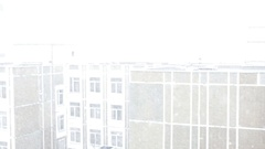 Snow on the building background Stock Footage