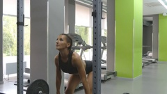 Young strong woman with perfect body in sportswear snatches heavy weight in gym. Stock Footage