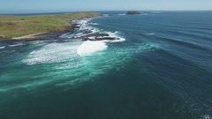 Slow rise above The Nobbies coastline and crushing waves at Phillip Island Stock Footage