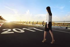 Female worker starts walking her journey on a street to success in 2017 Stock Photos