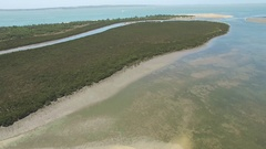 Forward flight over mangroves and water at Rhyll Inlet, Phillip Island Stock Footage