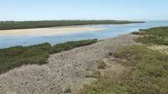 Slow rise with camera tilt above Rhyll Inlet, Phillip Island Stock Footage