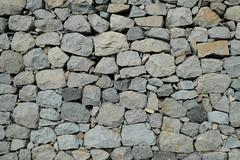 Natural stone wall background - rubble wall Stock Photos