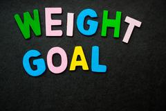 Weight Goal Colorful wooden letters forming the phrase Stock Photos