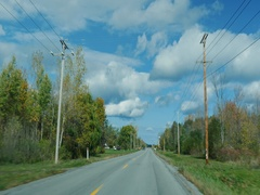 Drive along road typical small American town Stock Footage