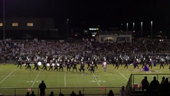 Aerial pan of high school band performing Stock Footage