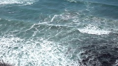 Slo mo high angle view of Pacific ocean rip curl breakers coming to shore Stock Footage